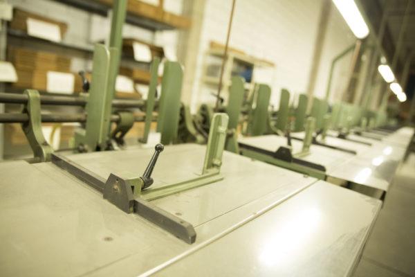 Plegadoras, alzadoras y cosedoras Litografía Romero, tu imprenta digital en Canarias